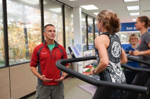 Coach Al speaking with ultra-runner and coach Debbie Livingston as she runs on the TrueForm Runner