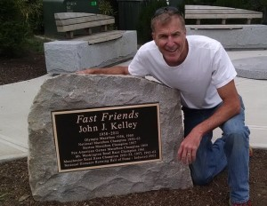 Local runner, Jim Roy, next to the plaque accompanying the statue of Kell. Jim was THE driving force behind the creation of a statue honoring Kell.