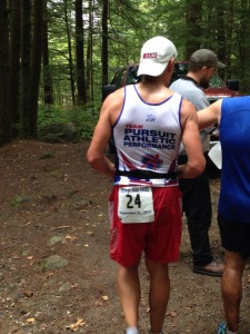 Coach Al (showing his back-side) at a Pisgah Mountain 50k aid station. Keeping it young!