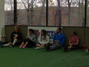 Team Pursuit members listen intently as Olivia Syptak guide them through the mental re-set process